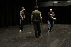 Josh Sanger (Tybalt) and Robert Herr (Romeo) receive instruction from Fight Director Jamie Treschak. Photo by David Vivian.
