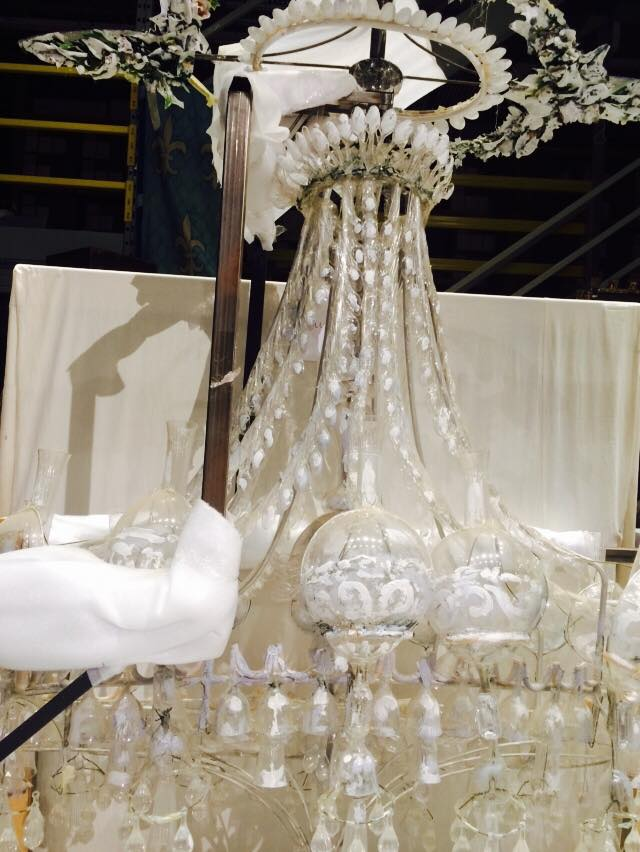 Chandelier designed by Desmond Healey. It's believed to be from a production of London Assurance. Made completely out of spoons, plastic goblets and bulbs- hand painted with broad brush strokes.